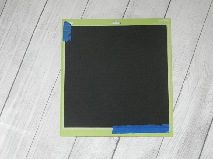 Tape your paper to your Cricut mat